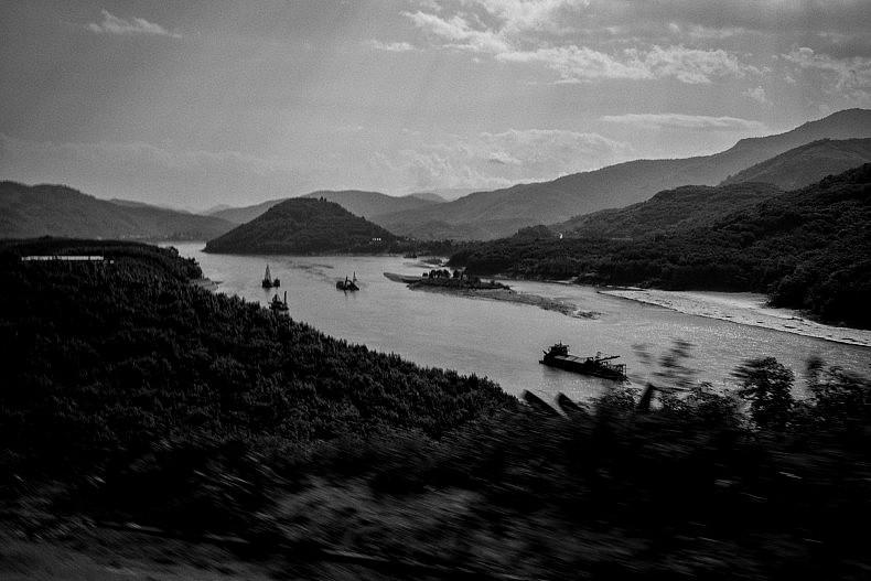 Sand dredgers work along the banks of the Lancang (Mekong) river in Simaogangzhen, Yunan, China. Photo by Gareth Bright.