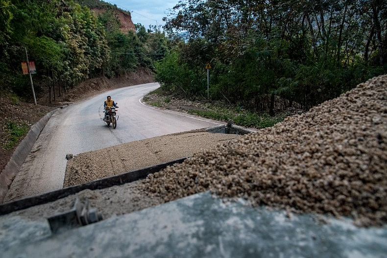 A driver hauls a load of sand to a construction site in Simaogang, Yunnan. Photo by Luc Forsyth.