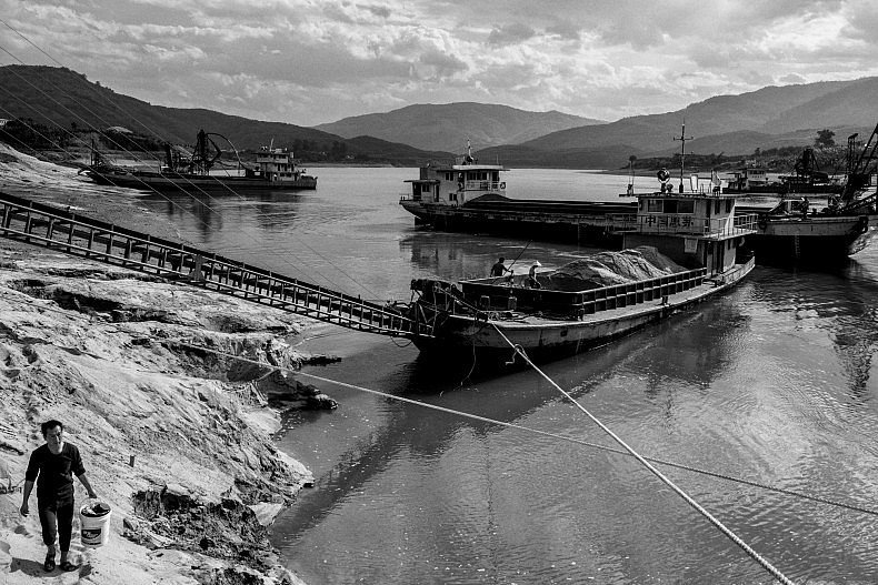 Mr. Shen says his ships extract more than 1500 tonnes of river sand each day, year round. Photo by Gareth Bright.