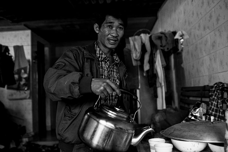 Pu'er tea pickers in their home. Photo by Gareth Bright.