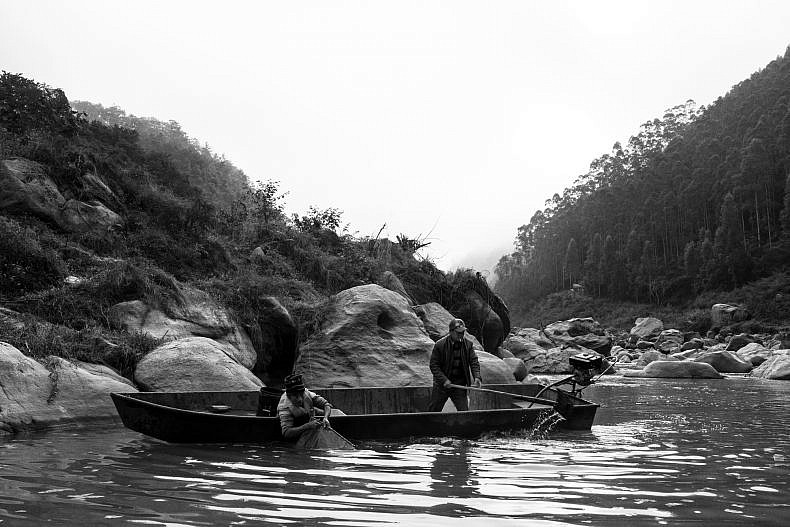 Fishermen on a tributary of the Lancang (Mekong) in Yunnan, China. Photo by Gareth Bright.
