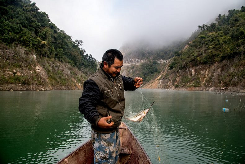 A fishermen checks his net on a tributary of the Lancang (Mekong) river in Jinglin. Photo by Luc Forsyth.