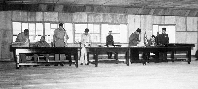 UN delegate Lieut. Gen. William K. Harrison, Jr. (seated left), and Korean People's Army and Chinese People's Volunteers delegate Gen. Nam Il (seated right) signing the Korean War armistice agreement at P'anmunjŏm, Korea, July 27, 1953. (Department of Defense)