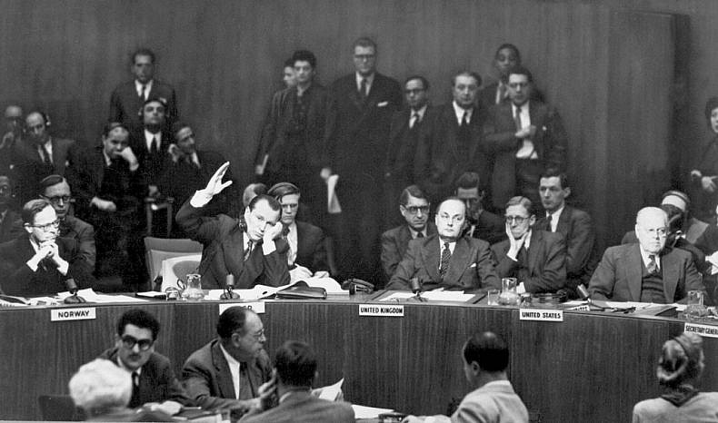 Jacob A. Malik, Soviet representative on the U.N. Security Council, raises his hand to cast the only dissenting vote to the resolution calling on the Chinese Communists to withdraw troops from Korea. Lake Success, NY. December 1950. INP. (U.S. Information Agency)