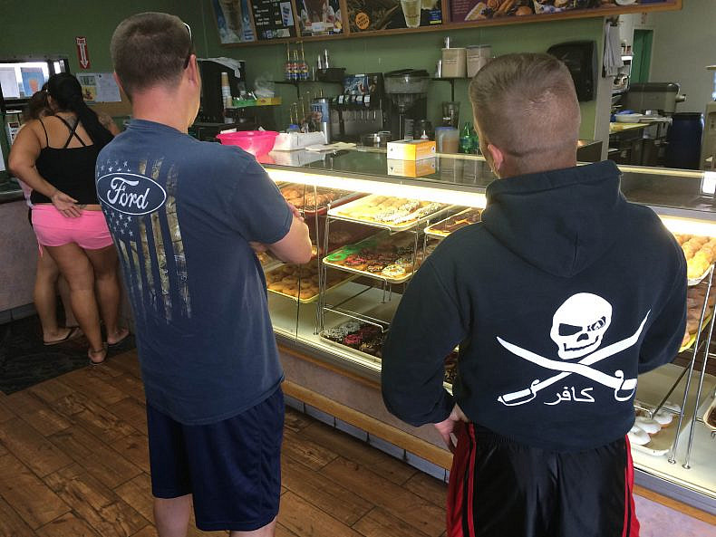 Two soldiers buying donuts at Winchells. Photo by Jon Letman