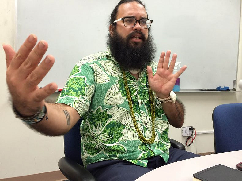 Dr. Bevacqua discussing the complicated relationship between the people of Guam and the U.S. military. Photo by Jon Letman.