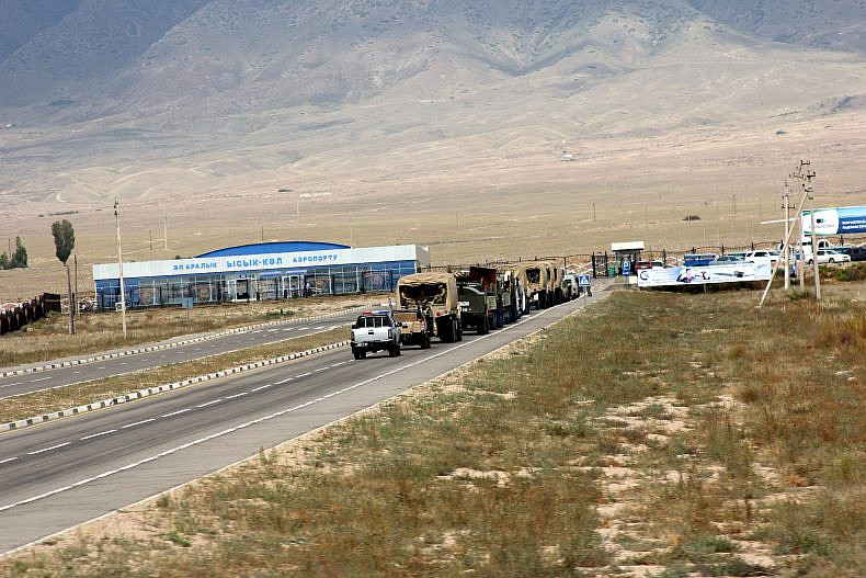 The road to the Issyk Kul International Airport, lined with troop carriers. Photo by Catherine Putz.