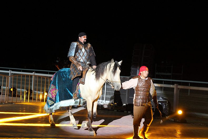 Steven Seagal rides a horse into the World Nomad Games. Photo by Catherine Putz.