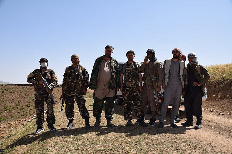 Haiot (third from the left), uprising commander and local head of the Afghan intelligence service, with his men - some official government forces, others vigilantes.