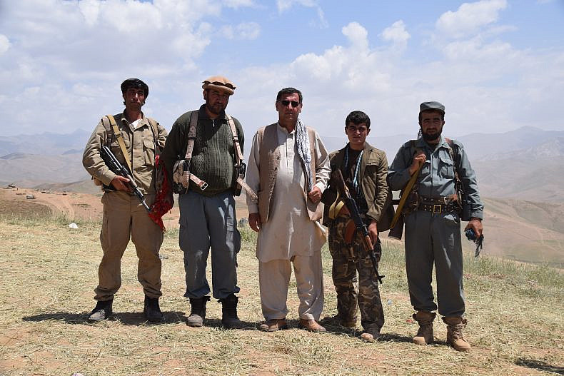 Men fighting the Taliban - some vigilantes, some vigilantes turned into Afghan Local Police and one member of the Afghan National Police.