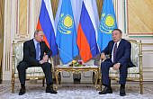Putin and Nazarbayev Trade Compliments at Business Forum