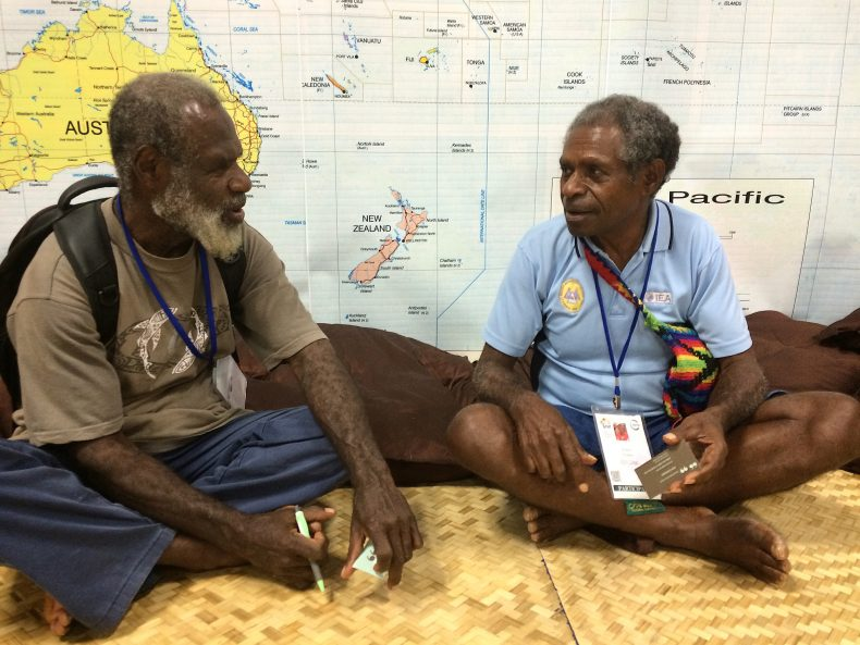 Two indigenous leaders from Papua New Guinea, Ware Melchior (left) and Porer Nombo, discuss the impacts of extractive industries on their sacred lands and water at the IUCN World Conservation Congress. Photo by Jon Letman.