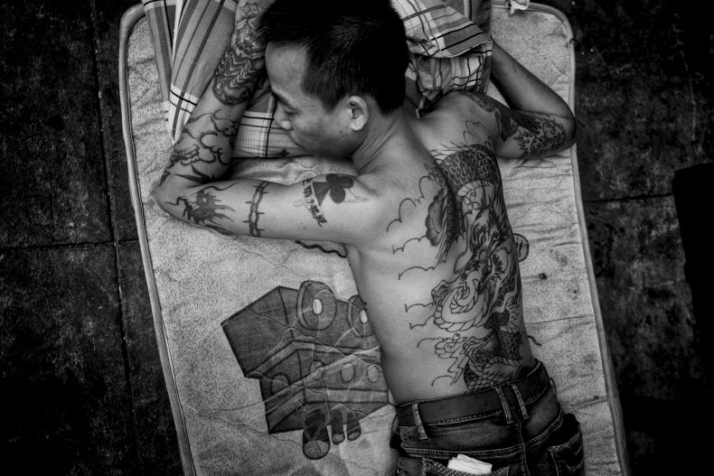 Man with the dragon tattoo, Hong Kong. Photo by Jonathan van Smit