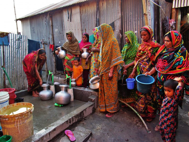 Women of Tetultola slum are being benefited from newly installed safe water supply system. CARE Bangladesh and VERC installed submersible pumps and water tanks in Tetultola slum to reduce water scarcity. Photo by Sakib Imtiaz.