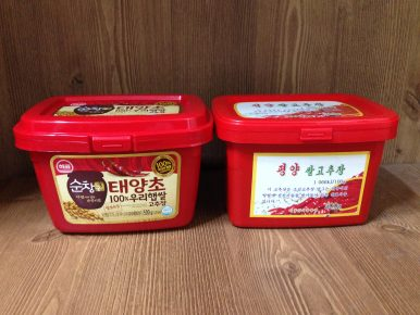 "A tub of South Korean gojuchang (left) alongside the North Korean-produced ""Pyongyang Rice Gochujang."" Image by Alek Sigley."