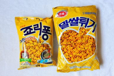 "Popular South Korean snack ""Jolly Pong"" (left) with its North Korean counterpart. Image by Alek Sigley."