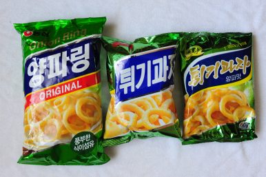"Popular South Korean snack, ""Onion Ring"" (left), with two North Korean variants. Image by Alek Sigley."