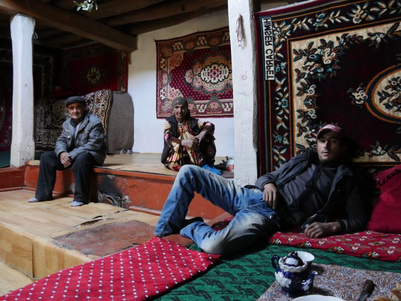 Pamir mountains, Tajikistan – Alek and his parents in their traditional Pamiri house. With no jobs and only heroin trade and addiction to turn to, Alek will go to Russia in spring to earn some money for his family. Image by Iris Oppelaar.