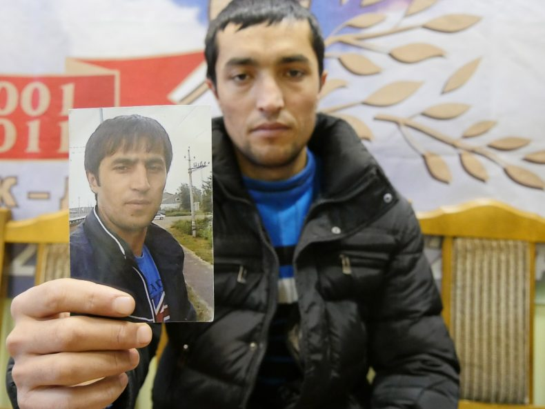 Moscow, Russia - A Tajik labor migrant holds up a picture of his brother, who has been missing for seven days. Image by Iris Oppelaar.