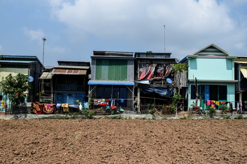The houses in the village are simply-made from brick, cement and metal sheeting, and lack the distinctive spirit houses found outside Buddhist houses in Cambodia. Image by Peter Ford.
