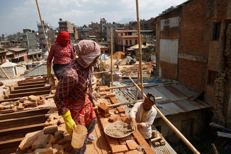 Local workers rebuild the temple which was destroyed by the April 2015 earthquake in Bungamati, Lalitpur, Nepal. Photo by Sunil Pradhan.