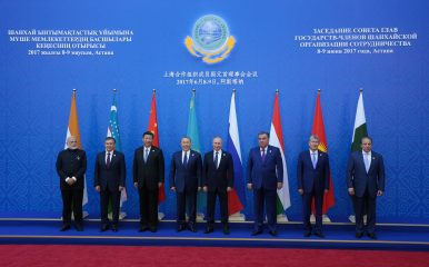 Summits, Roads and Suspended Disbelief in Central Asia