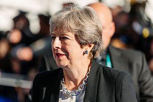 Theresa May to Visit China Ahead of Trump's Visit to Britain