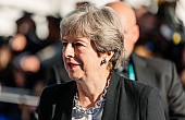 Theresa May to Visit China Ahead of Trump's Visit to Britain