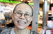 While China and Germany Sign Trade Deals, Liu Xiaobo's Widow Allowed to Leave China