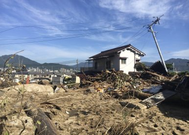 Japan Flood Recovery Efforts Hampered by Heat Wave