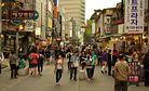 'Begpacking' Phenomenon Draws Scrutiny in South Korea
