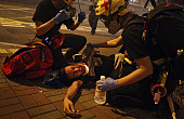 Beatings and Tear Gas: Violence Escalates as Hong Kong Protests Continue