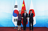 China Urges Dialogue During Trilateral Meet With Japan, South Korea