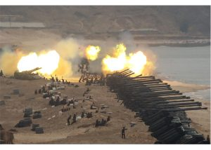 North Korea's Kim Jong Un Oversees 'Joint Strike' Military Exercise Amid Coronavirus Fears