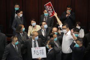 Lawmakers Ejected in Scuffles at Hong Kong's Legislature