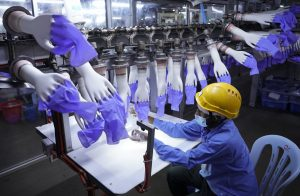 Debt Bondage Payouts Flow to Workers in Malaysia's Glove Industry